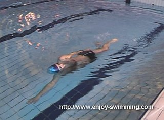 A swimmer practicing a the hand-lead side balance drill
