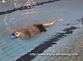 A swimmer practicing a the head-lead nose up / nose down drill