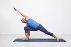 extended side angle #16 of the yoga poses for beginners