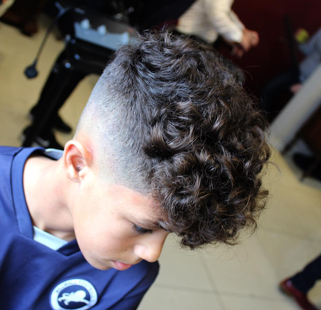 https://www.menshairstyletrends.com/wp-content/uploads/2017/12/chrisbryant93-fade-haircuts-for-boys-with-curly-hair.jpg