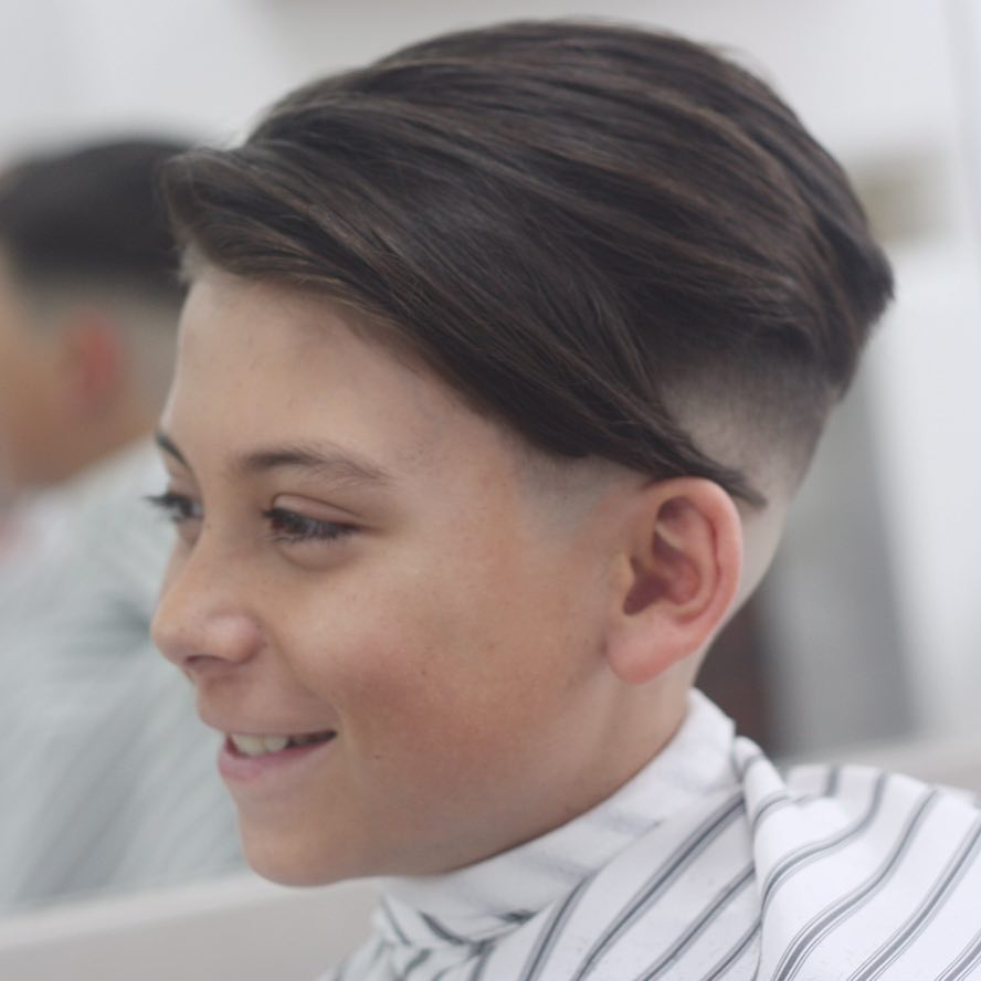https://www.menshairstyletrends.com/wp-content/uploads/2017/12/joshconnollybarber-medium-length-fade-haircuts-for-boys.jpg