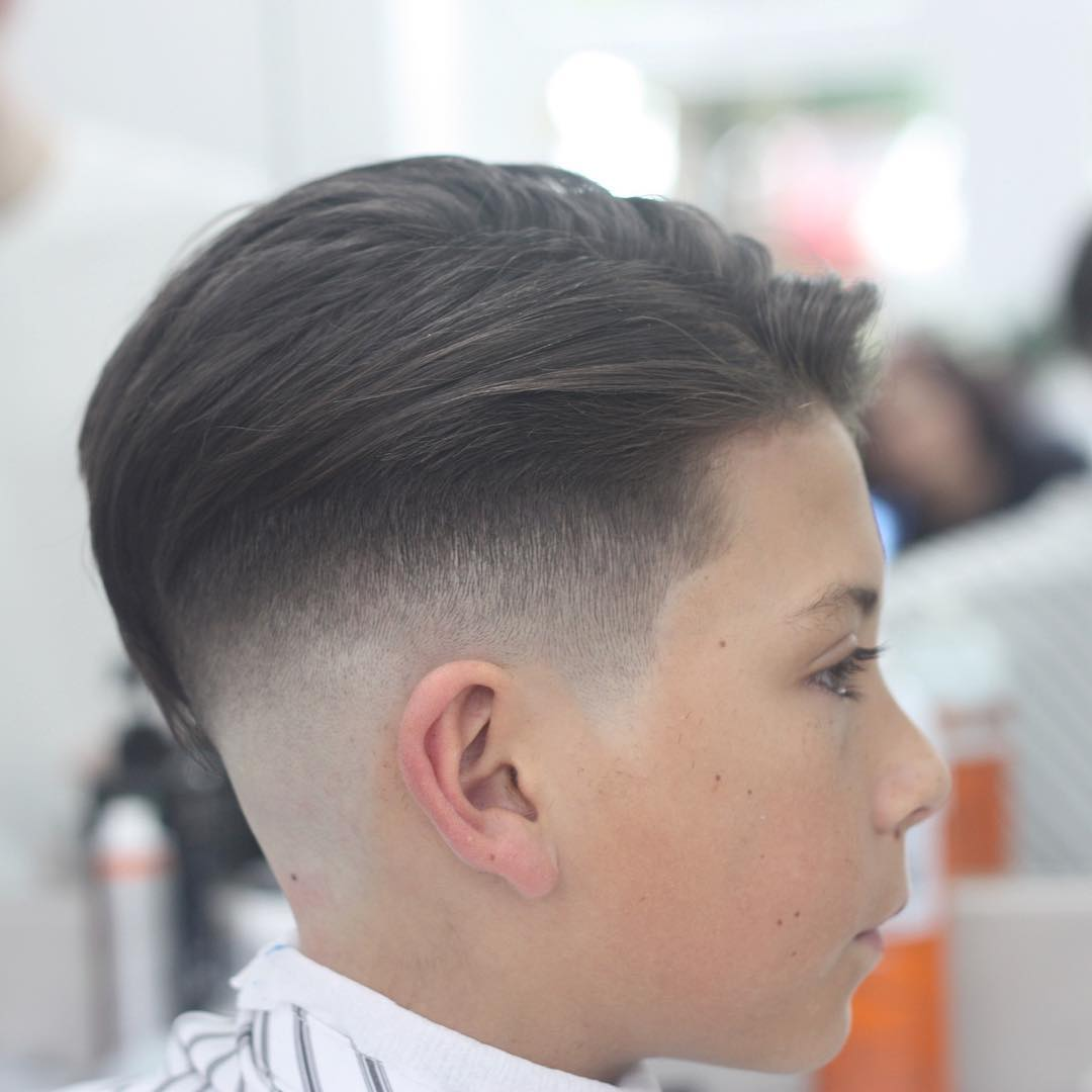 https://www.menshairstyletrends.com/wp-content/uploads/2017/12/joshconnollybarber-fade-haircuts-for-boys.jpg