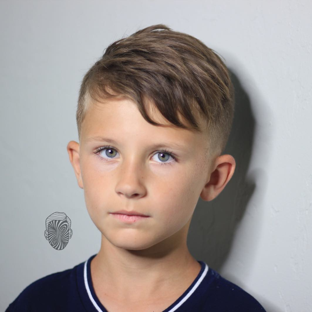 https://www.menshairstyletrends.com/wp-content/uploads/2017/12/travisanthonyhair-cool-hairstyles-for-boys-long-on-top-short-sides-2017.jpg