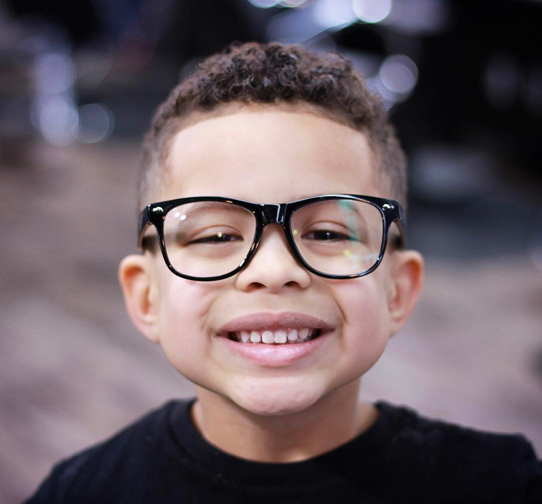https://www.menshairstyletrends.com/wp-content/uploads/2017/12/acutabovesparta-haircuts-for-boys-line-up-curly-hair.jpg