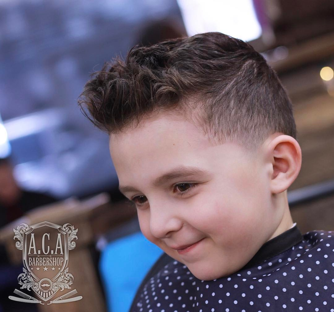 https://www.menshairstyletrends.com/wp-content/uploads/2017/12/acutabovesparta-fade-haircuts-with-boys-wavy-hair.jpg