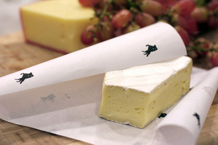 28 Food Storage Hacks - Wrap cheese with parchment paper.