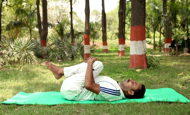 Apanasana (Knees to chest pose)