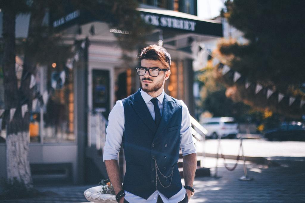 confident man with glasses standing outside character vs personality