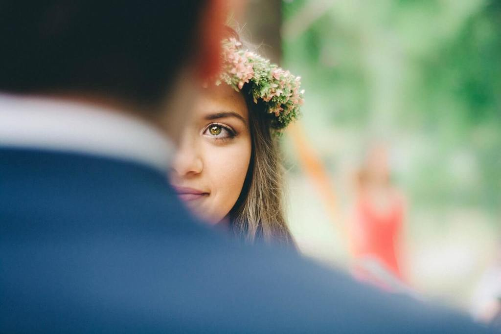 woman facing man with only half her face can be seen questions to ask before marriage